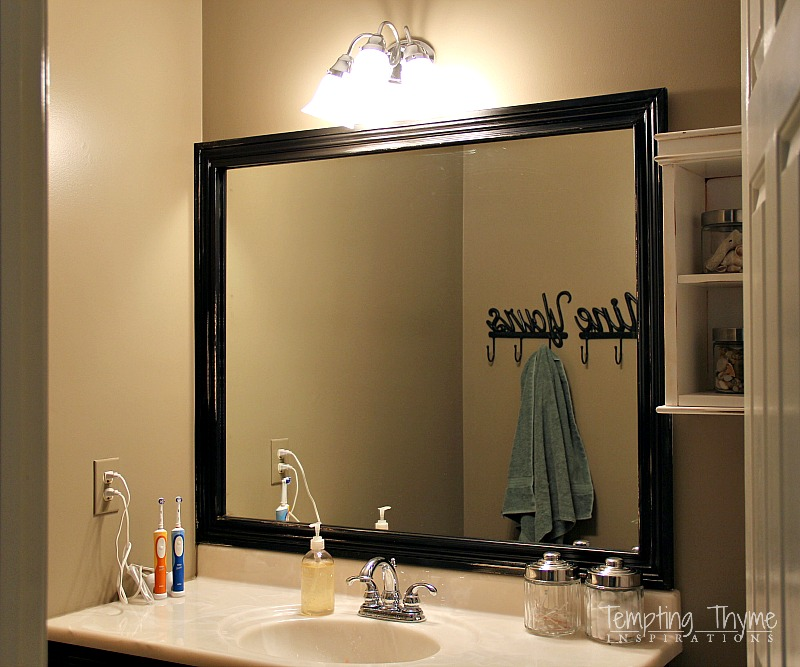 framing a boring bathroom mirror
