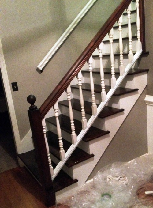 Taking the carpet off the stairs