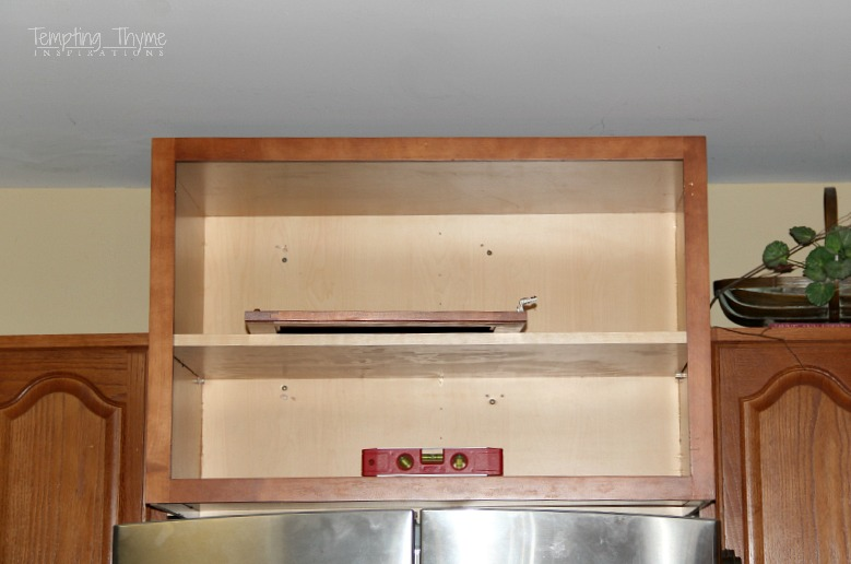 Installing a refrigerator cabinet not only gives you more storage space, but can make your kitchen look more customized.