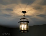 Spray painting a lantern light fixture from the Restore