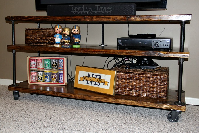 Quick and easy industrial tv cart using pipes, chunky wood and caster wheels.